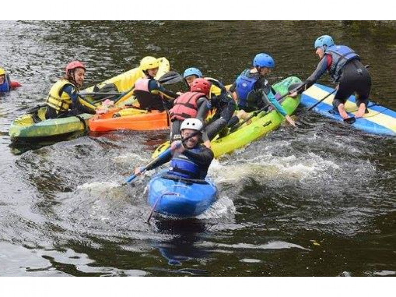 Kids, teens and adults kayaking Limerick City with Nevsail Watersports group event