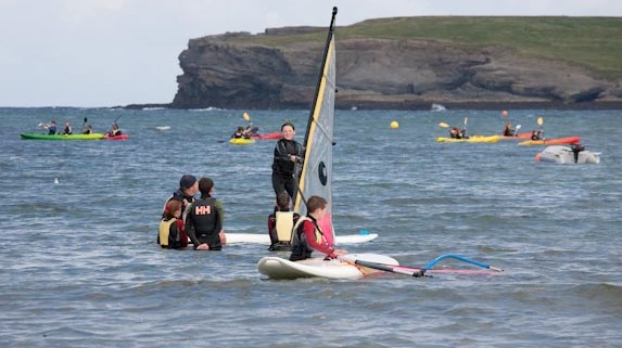kayaking and windsurfing on a school tour at Nevsail